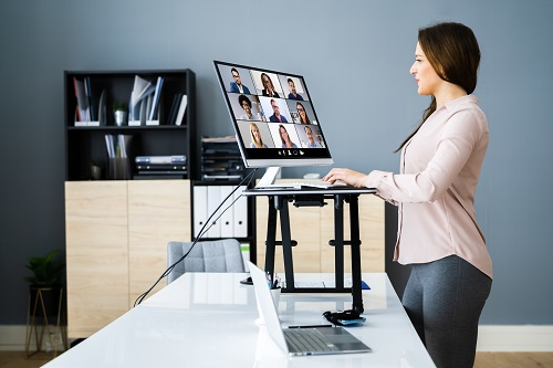 Lady attending standing meeting online